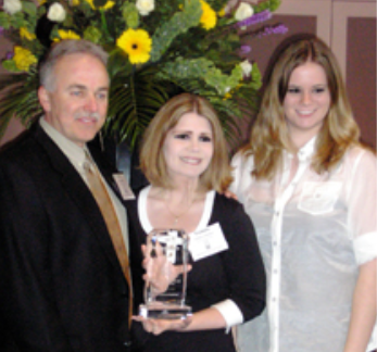 Jerry, Victoria, and Kelli accept GTS's second NEO Success Award