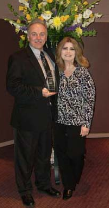 Jerry and Victoria Stallard Accept the NEO Success Award